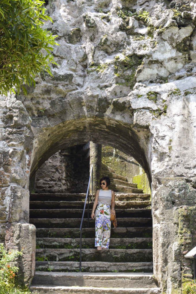 Baluarte de San Diego, Intramuros - Round straw bag, floral pants, striped sleeveless shirt | SamCora Blog 2