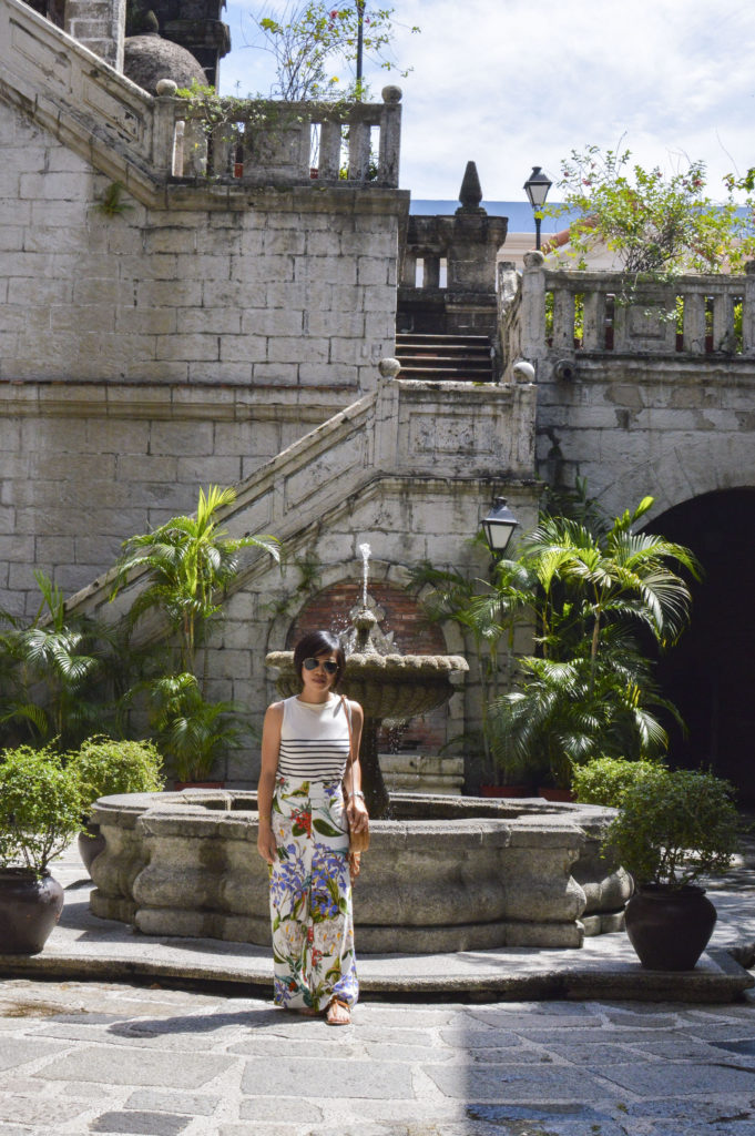 Casa Manila, Intramuros - Round straw bag, floral pants, striped sleeveless shirt | SamCora Blog
